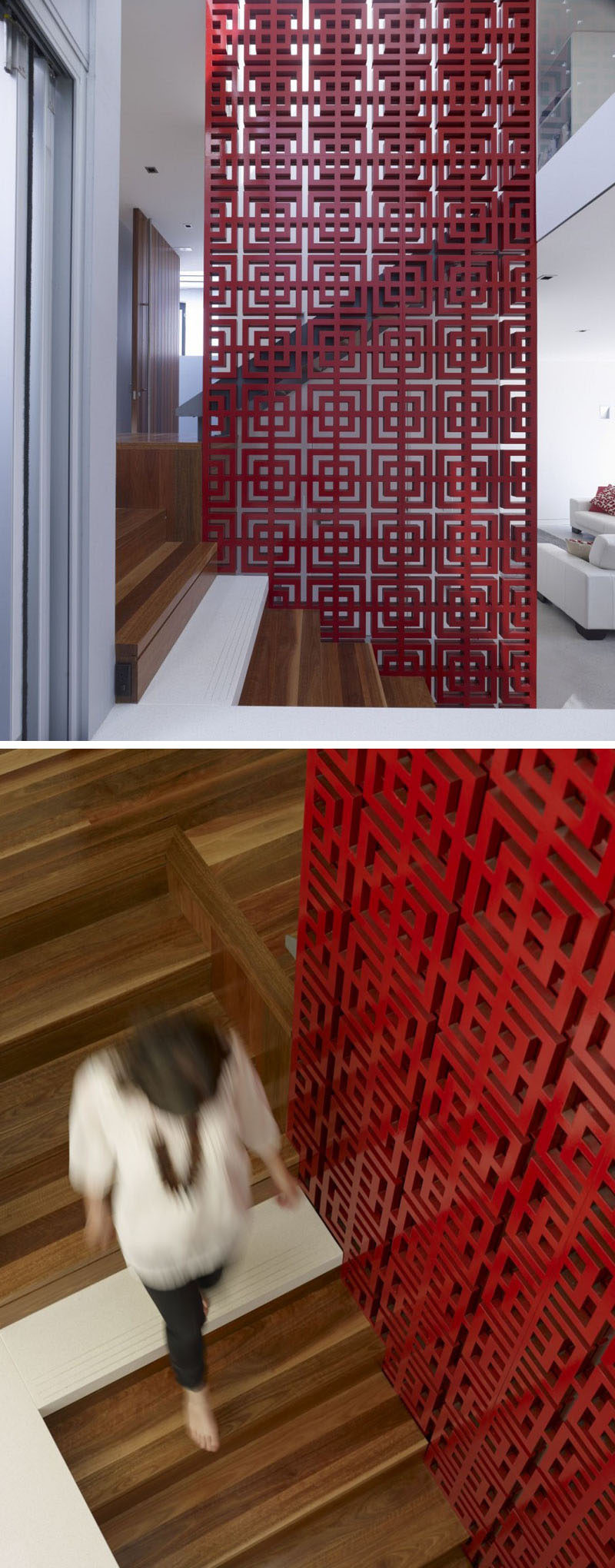 A patterned red safety railing on these wood stairs adds an artistic and bold statement in this modern house.