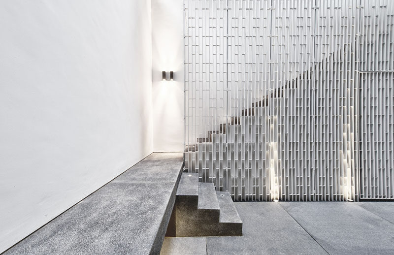 The metal safety railing on these stairs has a vertical pattern and adds dimension to the interior.