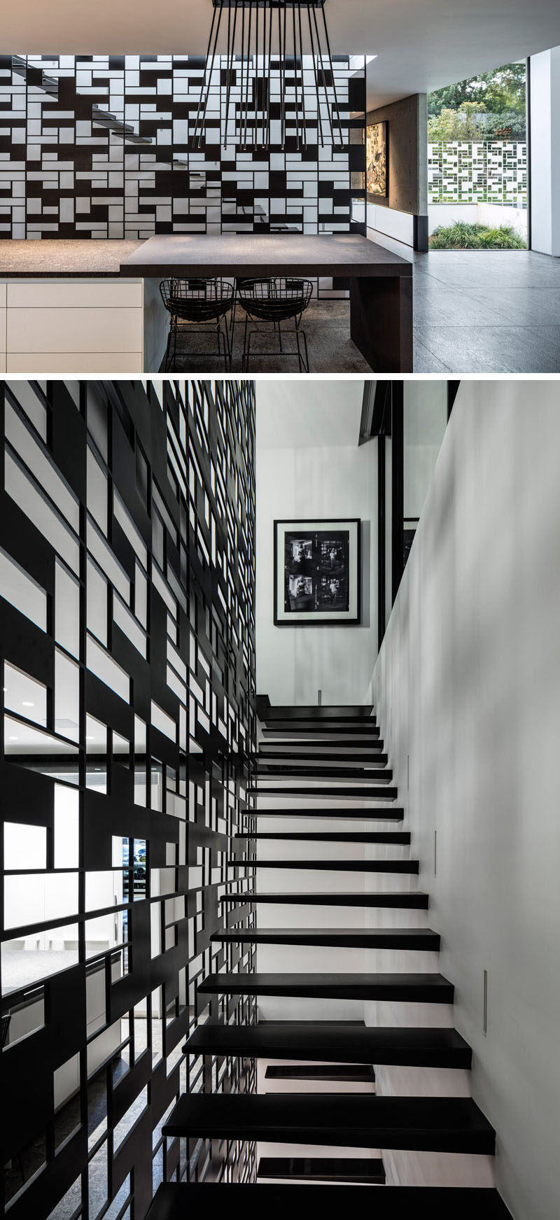 The black metal safety railing protecting one side of this staircase matches the design of a white fence that surrounds the house, creating continuity throughout the house and adding extra safety to the stairs.
