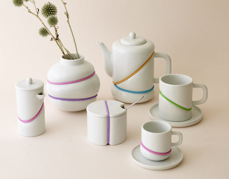 Serve your tea with a pop of color using this rubber band inspired tea set with brightly colored bands that give the set a fun modern look.