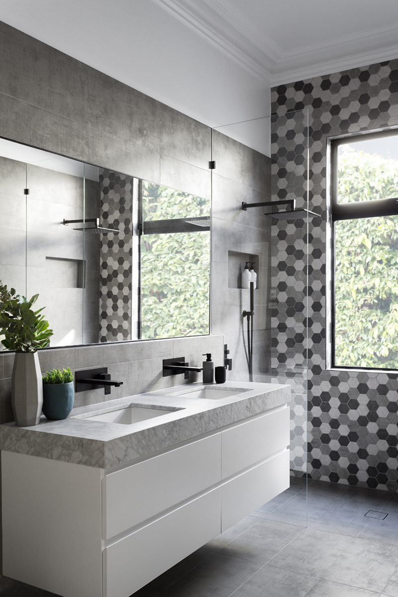 GIA Renovations Have Created A Modern Grey And White Bathroom With Matte  Black Accents, That