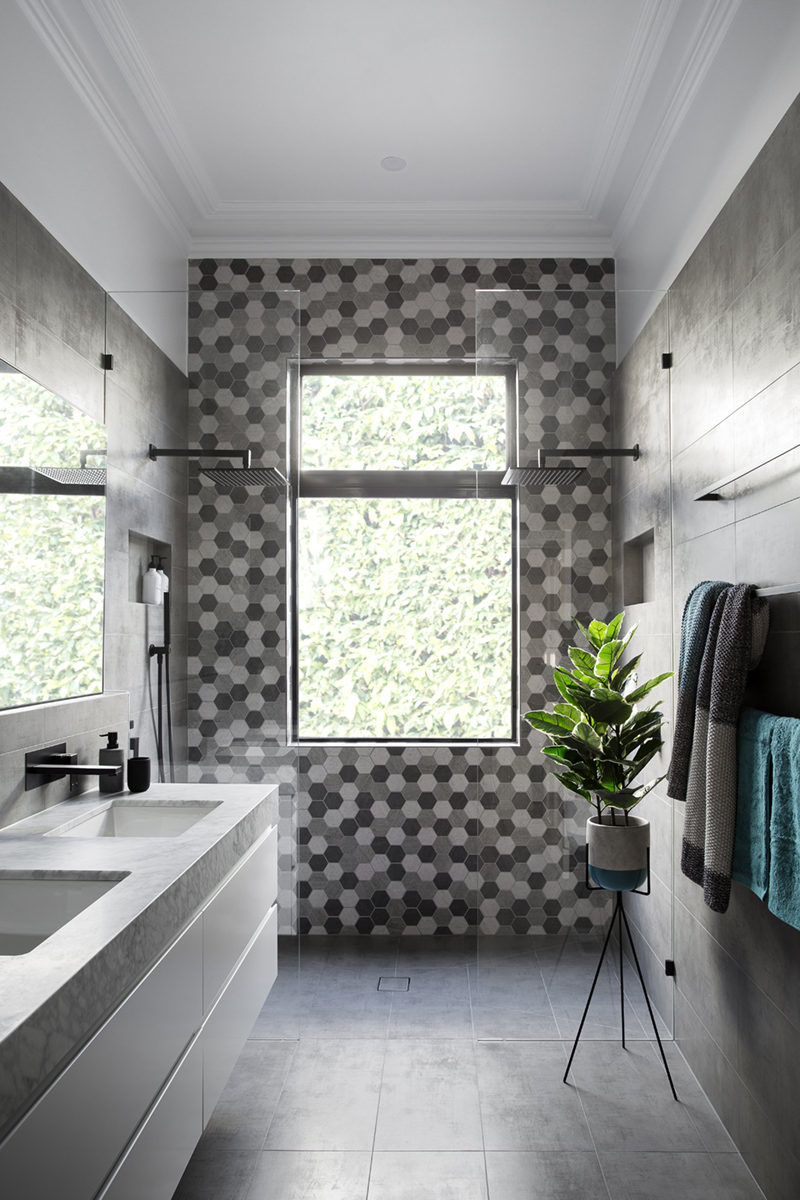 Matte Black Accents Add Sophistication To This Grey And White Bathroom