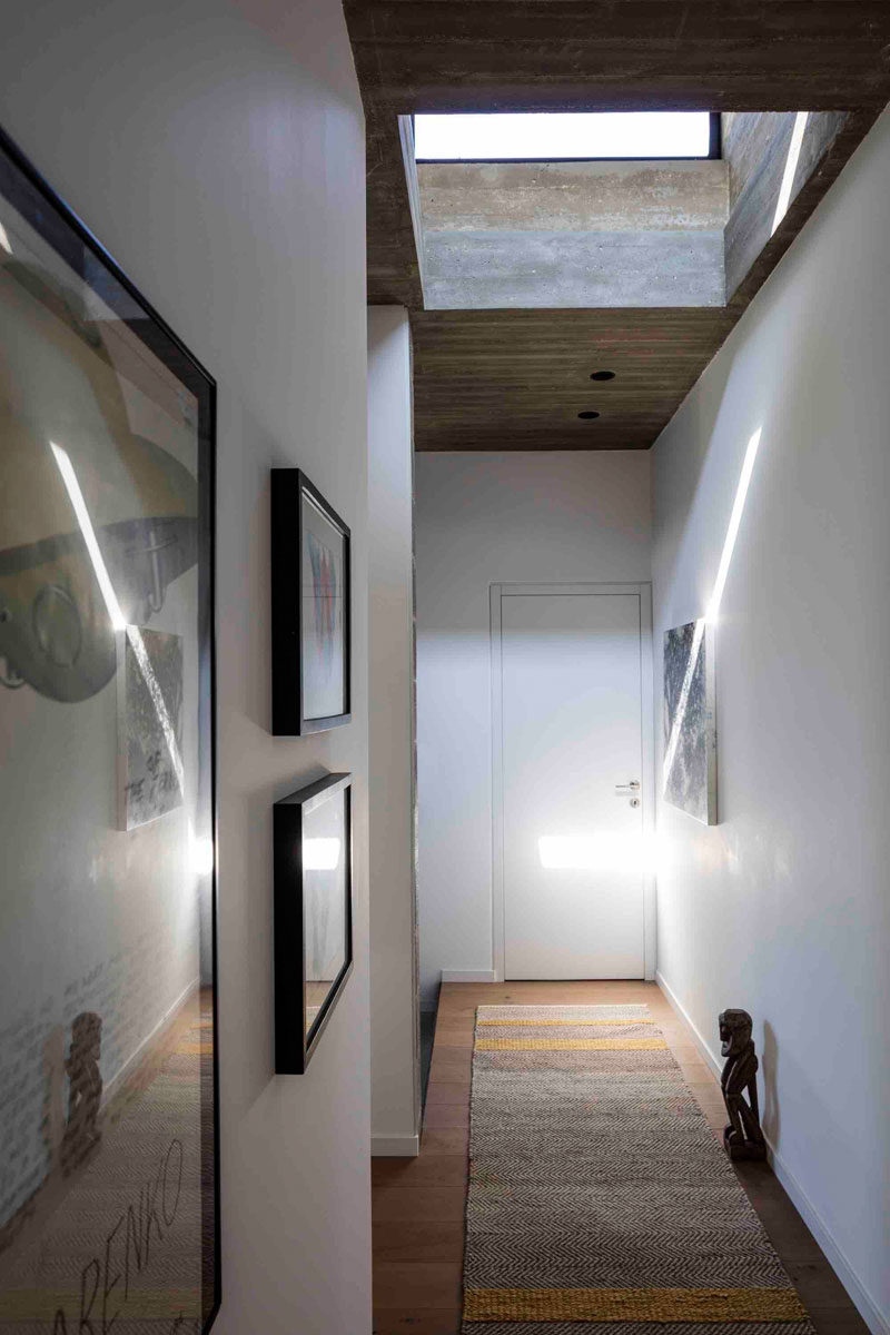 This hallway is kept bright by the use of a skylight that fills the area with natural light, and like the smaller windows in the living area, provides a glimpse of the sky.
