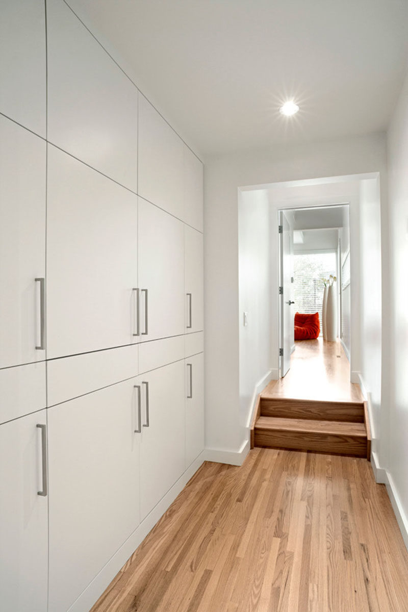 If you want to include a laundry in your home but are short on space, think about hiding the laundry room within closets. This laundry hidden within a wall of hallway closets features a washer and dryer as well as pull-out folding tables and an ironing board.