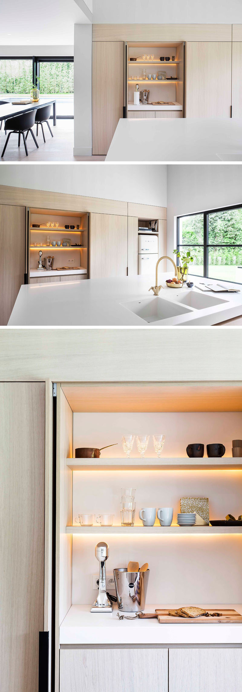 In this modern kitchen, minimalist black cabinet hardware allows you to easily open the cabinet, with the doors folding away within the cabinetry. One design feature hidden within this particular cabinet with an internal countertop, is the LED lighting that's hidden behind the shelves to brightens up the space without having to turn on the main kitchen lights.
