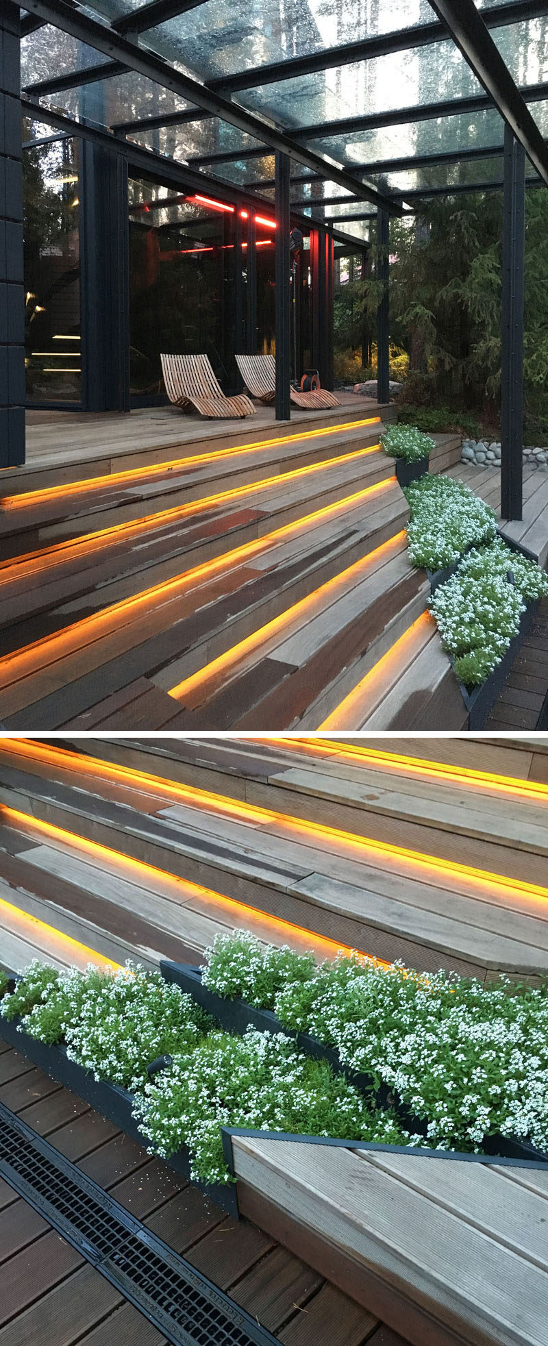 The landscape design of the outdoor space at a gym has built-in planters and hidden lighting within the wood steps.