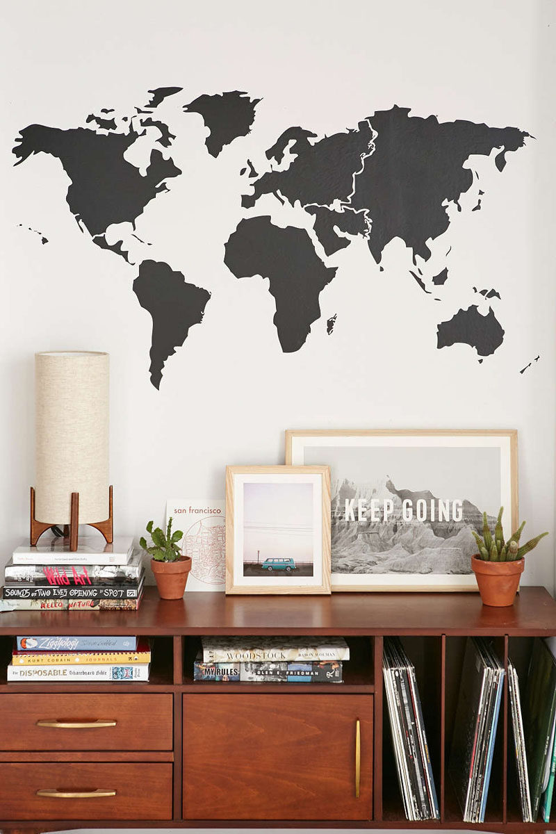 10 world map designs to decorate a plain wall contemporist this black minimal world map wall decal is the perfect addition to the wall above a shelf or table dedicated to your worldly travels gumiabroncs Images