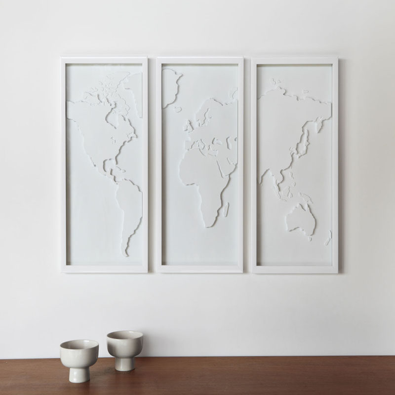 this simple set of framed panels of the world puts a more artistic spin on the world map and adds a more decorative look to your walls
