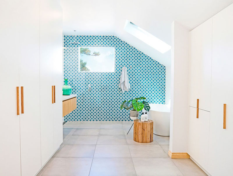 This white and wood bathroom has a bright blue accent wall for Warm feel bathroom floor tiles