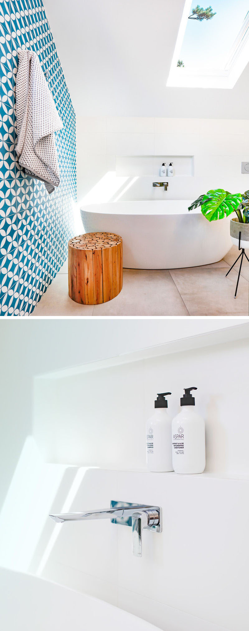 This modern blue and white bathroom has a built-in shelf above the freestanding bathtub to keep all the necessities within arms reach.