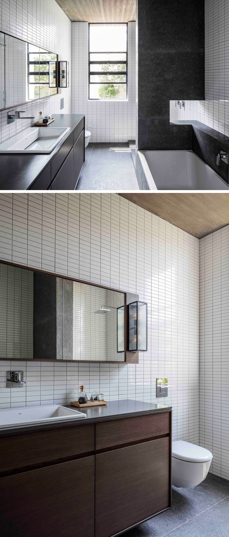 In this master bathroom, small white rectangular tiles cover the walls from floor-to-ceiling, and dark elements like the bath and vanity compliment the black window frames.