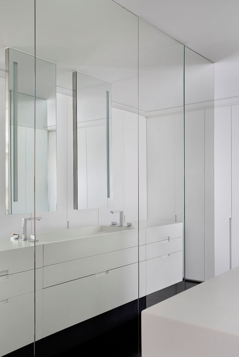 Full floor-to-ceiling mirrors cover these closets in this modern bathroom and allow you to check your outfit from every angle before stepping out.