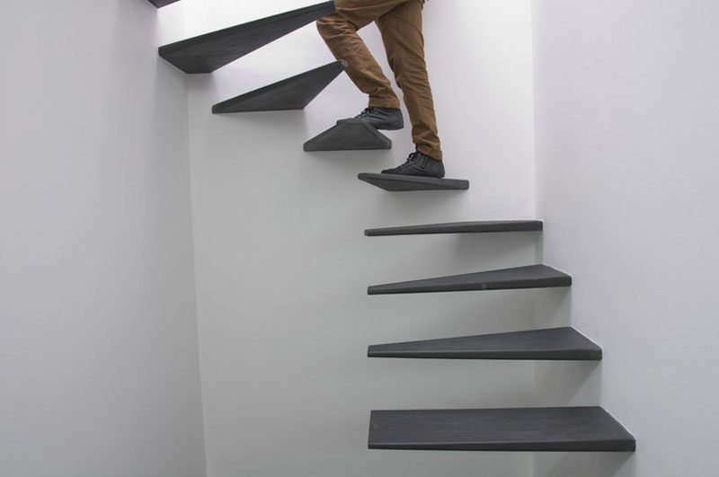 These Floating Black Stairs Were Custom Designed For This Home And Are A  Creative Alternative To A Spiral Staircase.