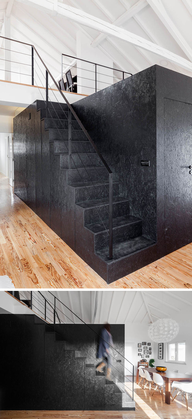 These black stairs attached to a black wooden box, feature hidden storage and lead up to the loft area of this converted barn.