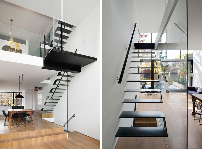 Black steel plates were welded together to create these modern floating stairs that are protected on one side by a glass window that keeps the staircase bright and visually connected to the rest of the home.