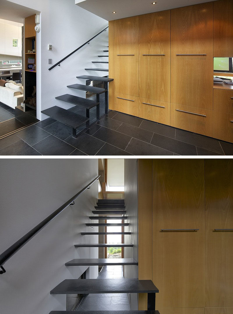 These thin black stairs let light pass through the openings and make the staircase feel bright and airy despite the black color of the steps.