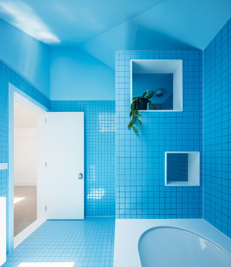This 1930s brick bungalow received a contemporary update Bright blue tile