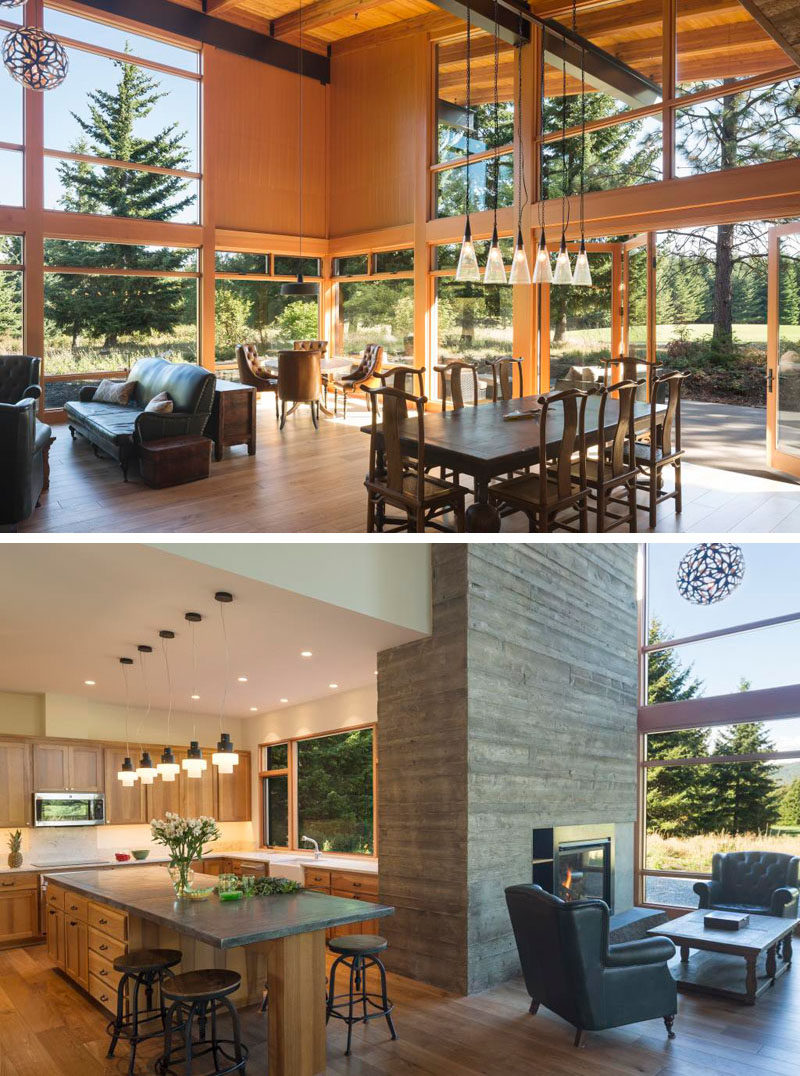 Inside this modern wood cabin, large floor-to-ceiling windows fill the main living area of the cabin with lots of natural light and let you take in the views of the surrounding landscape without having to be outside. Double height ceilings help the space feel open and airy, while the tall board formed concrete chimney provides a cozy gathering spot in the winter and acts as a main focal point in the living area.