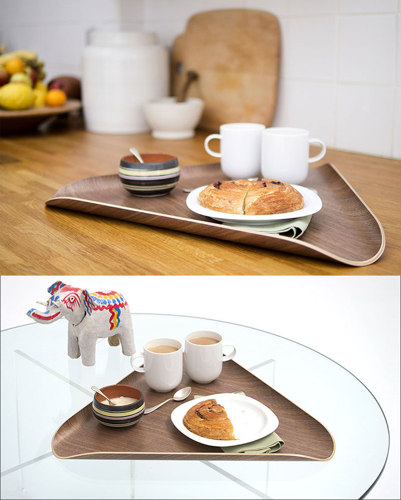 The curved edges of this triangular wood tray give it a unique look and soften up the typically angular shape of the tray.