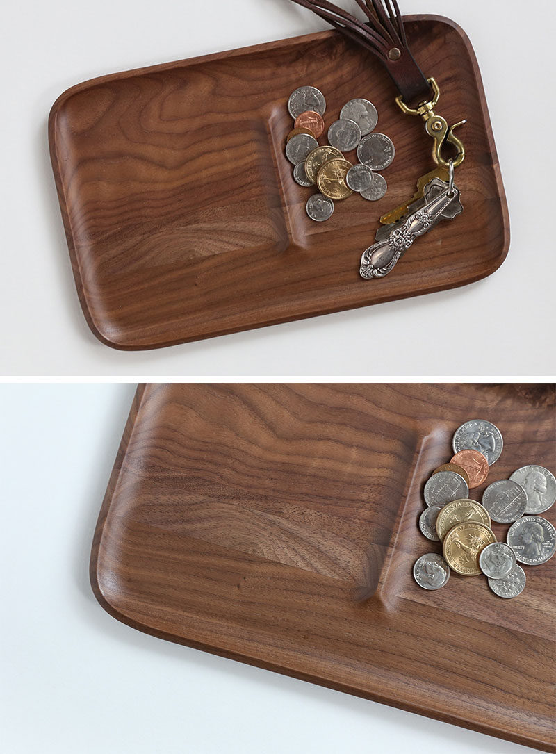 This large walnut tray features a ridge in the middle to create two sections that make it easier to keep things separate and organized.