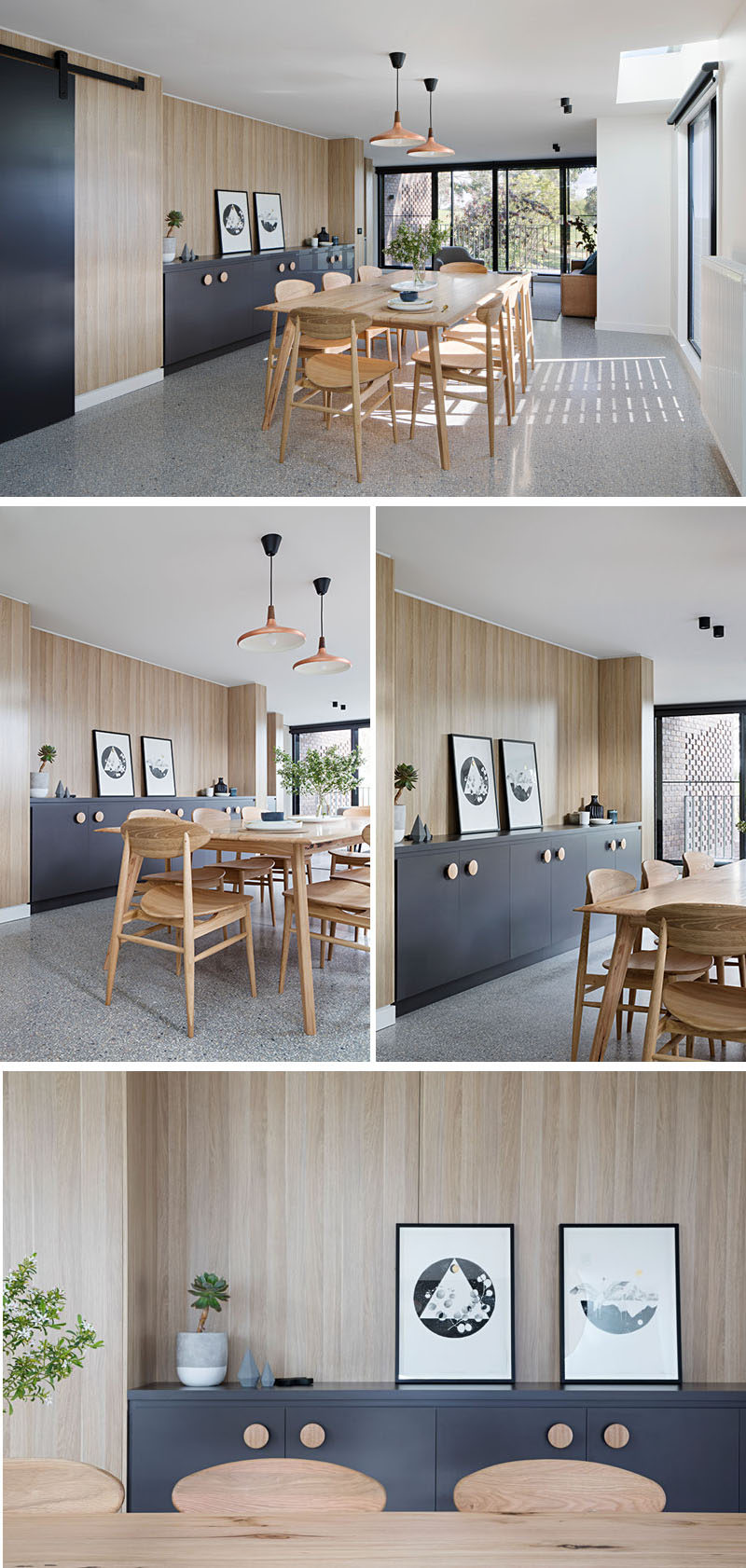 In this modern dining room, light wood dining table and chairs play off the light wood walls, and a matte black built-in sideboard with wood handles provides ample storage and a place to display decorative items.