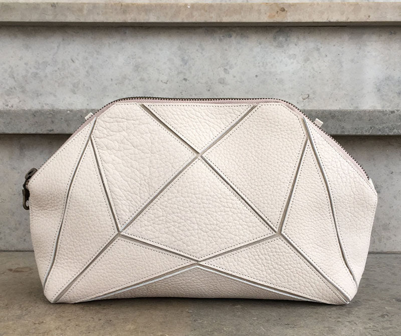 The Fold It! XXL Clutch with its geometric design, can be configured in multiple ways, including a clutch, a cross body bag and a toiletry bag. The shapes also allow the bag to be folded down completely to make it easy to pack with you in a suitcase.