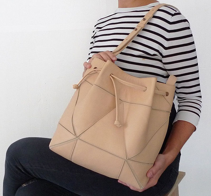 The Fold It! Bucket Bag was designed to allow you to get multiple styles out of a single bag. Able to be both a large bucket bag and a smaller cross body bag, the Fold It! Bucket bag uses geometric design to create a simple modern purse.
