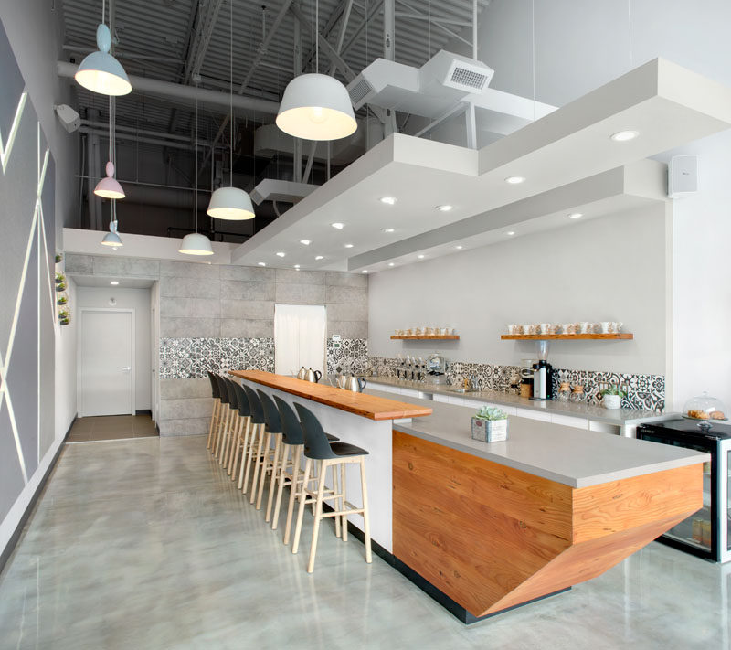 This Modern Coffee Shop Has A Palette Of Grey White And Wood