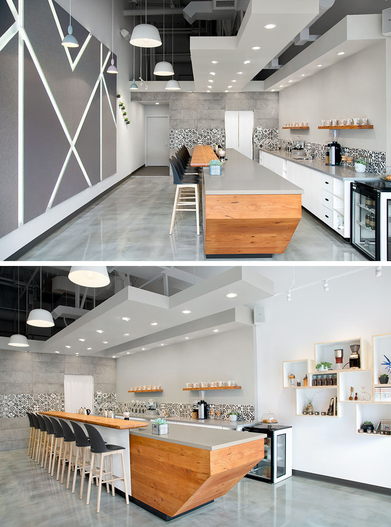 This modern coffee shop has a palette of grey white and - Grey wood floors modern interior design ...