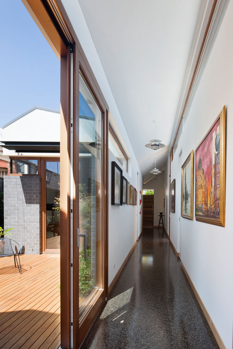 This hallway has a sliding door that provides access to an internal courtyard.
