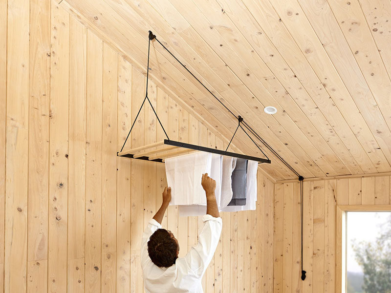 New Zealand based design firm George and Willy have created a modern hanging  clothes drying rack