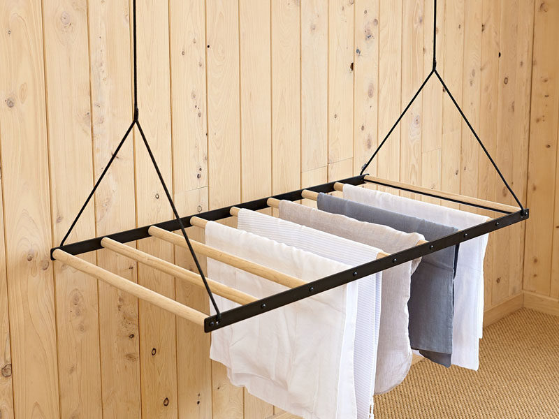 New Zealand based design firm George and Willy have created a modern hanging clothes drying rack that drops from the ceiling on a pulley system to dry and air your clothes.