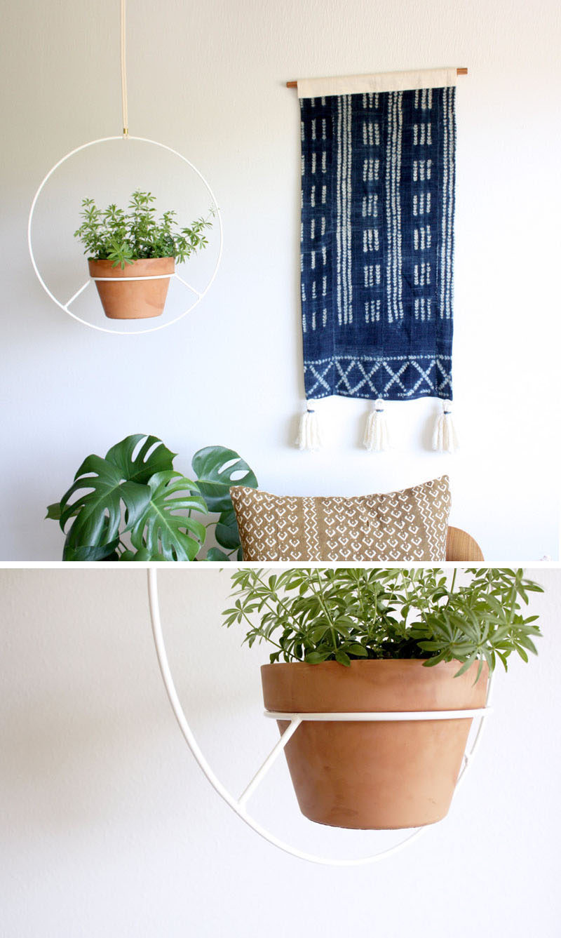 Inspired by vintage hanging plant holders, Angie Johnson has created this modern white hanging planter.