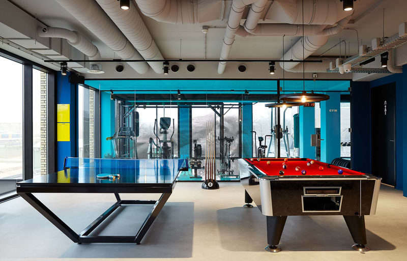In this modern hotel, the games room has ping pong tables and a large pool table. Large floor-to-ceiling windows provide views of the city and fill the room with natural light.