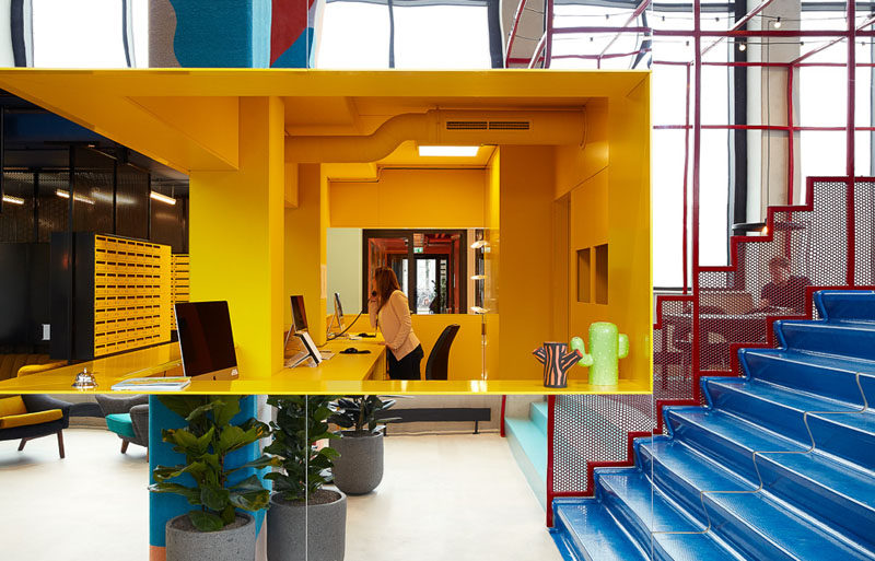 In this modern hotel, a bright yellow check-in desk is impossible to miss and happily greets people as they arrive for their stay.