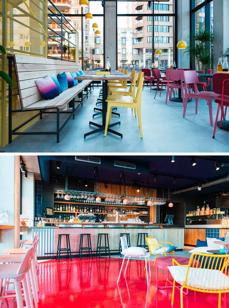 In this modern hotel restaurant and bar, fun colors have been combined with bright furniture, yellow pendant lights, and a bright pink floor.