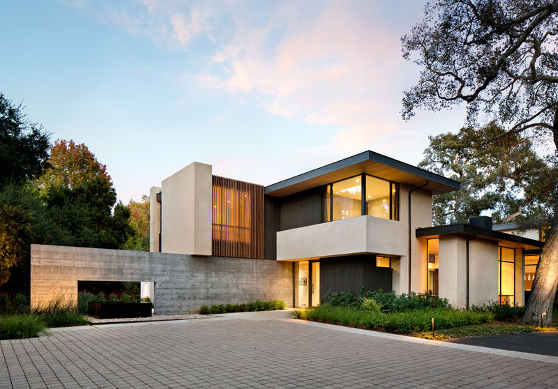 This california home preserved the existing trees to for Home plans california