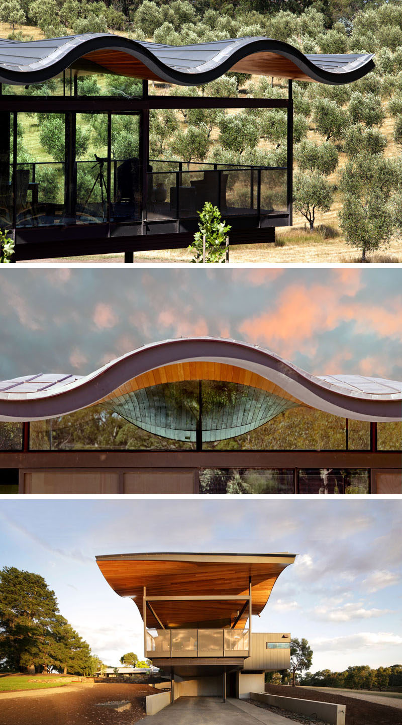 This modern house in Australia features a sculptural and wavy roof made from metal and wood, that's been designed to mimic the rolling hills surrounding the home.
