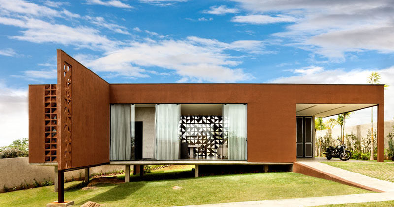 1:1 arquitetura:design have designed Casa Clara, a small house in Brazil for a couple and their child, that has a steel frame and a decorative block pattern.