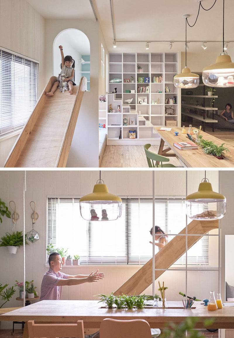 This modern apartment features a lofted play space just off the kitchen with a wood slide attached to it, making it super quick to come down for snacks.