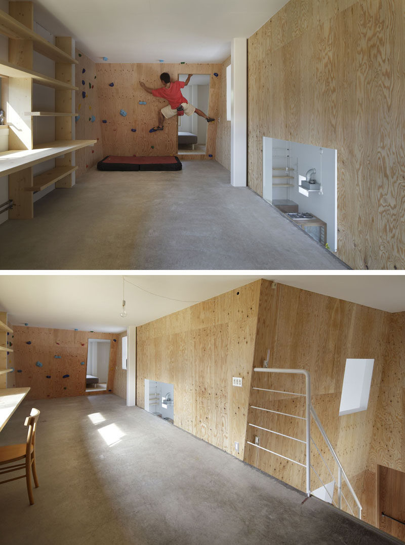The rock climbing wall in this modern house has been placed on a slight angle to make the climb more challenging and wraps around the wall to give you more of a workout.