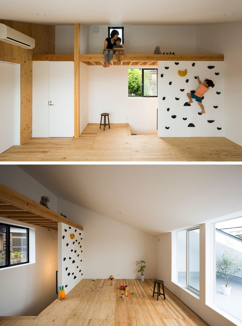 The small rock climbing wall in this modern house leads up to a lofted space that can be used for playing, reading, napping, or just hanging out.