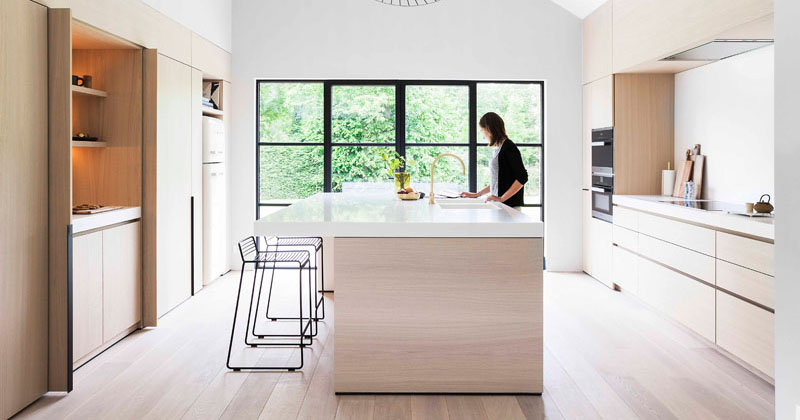 Light Wood And White Countertops Create A Neutral Softness In This Kitchen