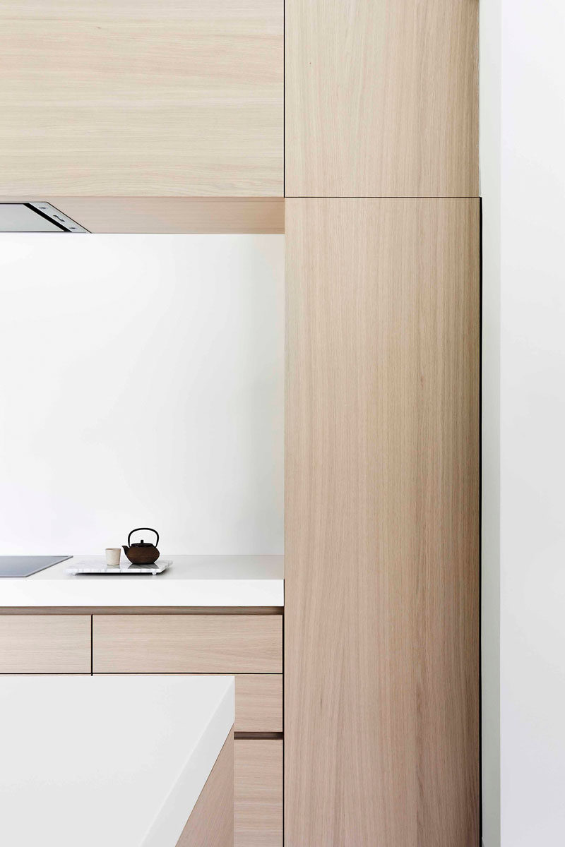 In This Modern Light Wood And White Kitchen, The Cabinets Are Mostly Free  Of Hardware