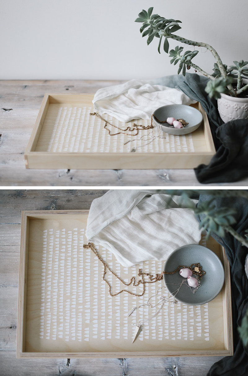 The minimalist white design on the inside of this light wood tray adds a whimsical touch while still keeping the look of the tray modern and clean.