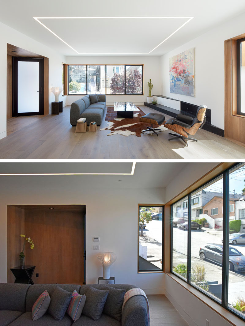 Just inside the entrance of this modern house is the living room that overlooking the street at the front of the house, and is defined by the built-in lighting in the ceiling.