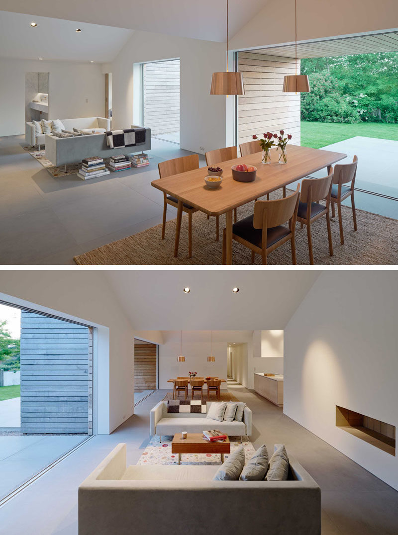 Inside this modern house, the living room and dining room share the same space, however each part of the room opens up to the outdoors.