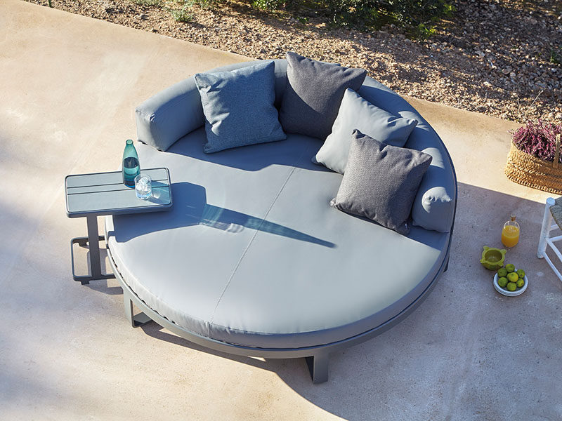 A circular outdoor bed with lots of support is great for casual lounging as well as late afternoon snoozing.