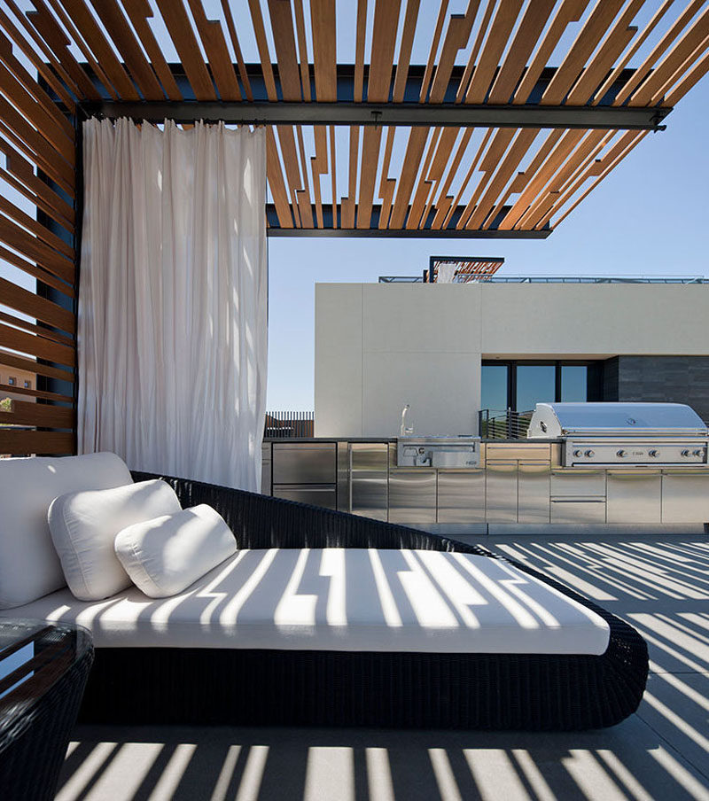 Depending on the occasion, this daybed with a sheltered pergola can be used as both a couch when entertaining groups or an outdoor bed perfect for lounging on a hot afternoon.