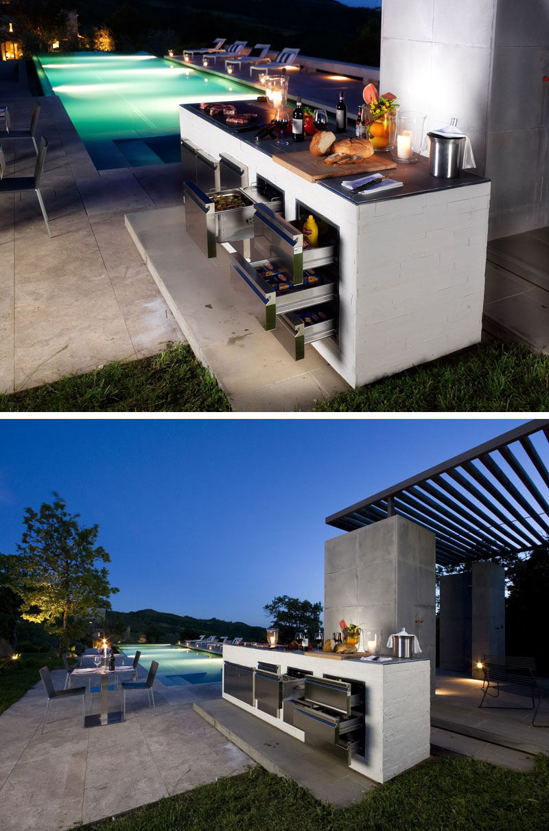 This modern outdoor kitchen and grill has built-in refrigerated drawers so that the food that needs to be kept cool right up until it hits the grill is fresh, even if you have to cook it later.